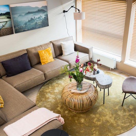 grote woonkamer inrichten met royale meubels Eijerkamp